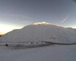Snow on the Crown Range near Queenstown this morning. Photo: MetService webcam