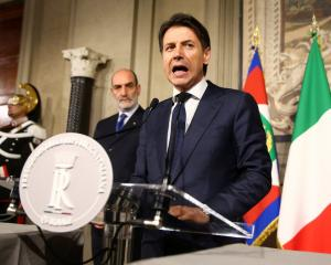 Italy's Prime Minister-designate Giuseppe Conte speaks to the media after a meeting with the...