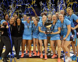 The Southern Steel players and staff celebrate with the ANZ Premiership trophy  after beating the...