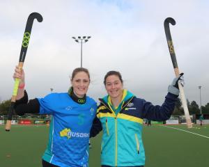 Australian national women's hockey team members Ashlee Wells and Karri McMahon get ready for the...