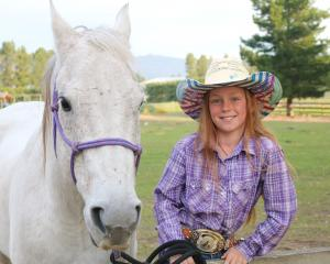 Sky Sanders (10), here with her horse, Cougar, looks forward to competing in an international...