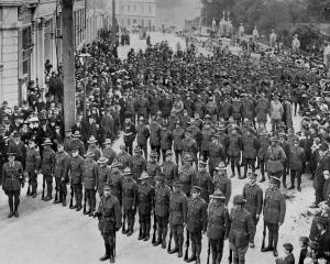 Anzac Day in Dunedin: returned soldiers parade in front of Anzac House in Moray Pl before moving...