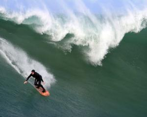 Dunedin surfer Leroy Rust takes on some early season big surf at Kings Rock, Papatowai, in the...