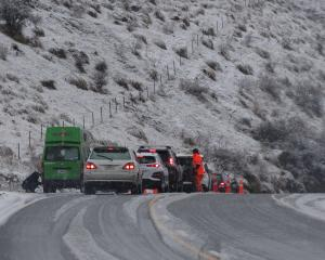 Motorists on the Crown Range Rd yesterday had to fit chains before the summit after snow fell on...