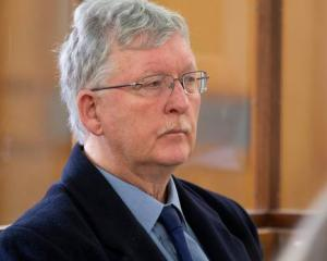 Kapiti Coast councillor David Scott sits in the dock on day one of his trial for indecent assault...