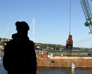 Otago Yacht Club manager Barry Gibbs watches as dredging starts in the Otago Boat Harbour...