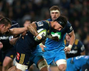 Elliot Dixon carries the ball for the Highlanders against the Blues earlier this season. Photo:...