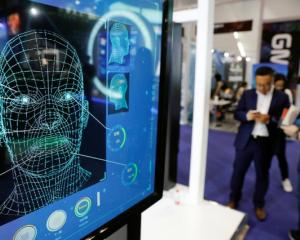 Screen advertising facial recognition software. Photo: Reuters