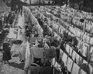French women washing for British soldiers: lines of shirts hung out to dry.