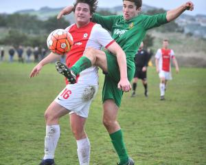 Ryan Fleming (left), of Caversham, and Tom Milton, of Green Island, battle for the ball during a...