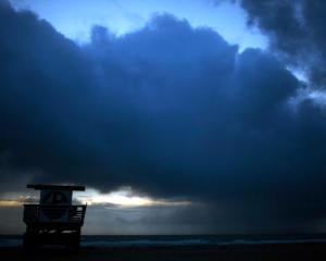Storm clouds over a lifeguard station on Miami Beach in Florida. File photo: Getty
