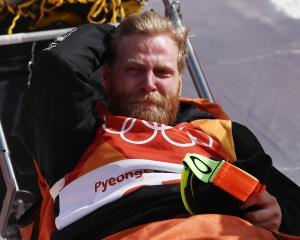 Byron Wells is stretchered off by medical staff after his crash at the Olympics. Photo: Getty Images