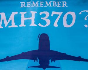 A MH370 poster shown at the 4th Annual MH370 Remembrance event in Kuala Lumpur in March. Photo:...