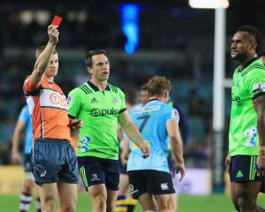 Referee Brendon Pickerill shows Highlanders winger Tevita Nabura a red card as co-captain Ben...