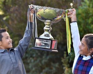 Kairangi (9) and Anahera Koni (8) hold aloft the transtasman trophy they helped win. Photo: Peter...