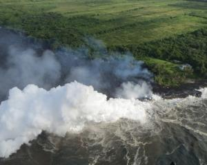 Hot lava entering the Pacific Ocean creates deadly white clouds of acid. Image: Reuters