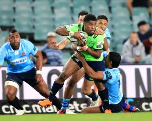Aaron Smith is tackled during the match between the Waratahs and the Highlanders in Sydney. Photo...