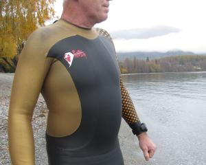 Eddie Spearing, of Wanaka, models his freshwater wet suit. Photo: Mark Price