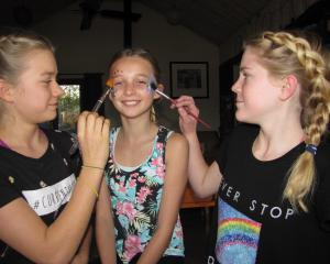 Lauren Rimmer and Maisy Millwater, of Hawea Flat, use non-plastic ''bio-glitter'' on model Tia...