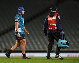 James Parsons leaves the field for a concussion test during the Blues' match against the...