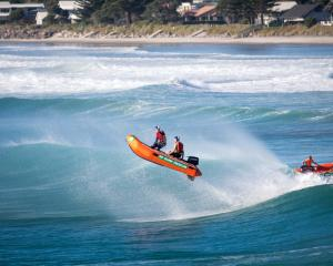 Warrington's Taryn Doyle (driving) and Kayle Harris hit a Waihi Beach wave during the assembly...