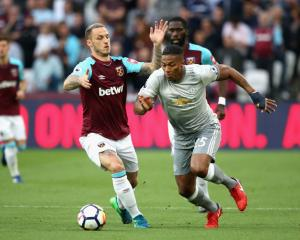 Antonio Valencia of Manchester United goes past Marko Arnautovic of West Ham United. Photo: Getty...