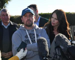 Sharemilker Leo Bensegues and Prime Minister Jacinda Ardern on his farm near Morven. Photo:...