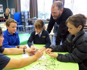 Niwa air quality scientist Gustavo Olivares, of Auckland, helps Alexandra Primary School pupils ...