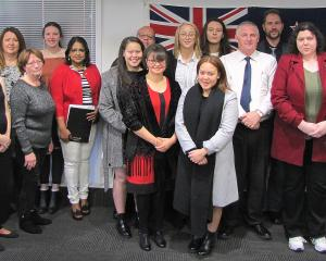 Central Otago Mayor Tim Cadogan (right) celebrates with new Central Otago citizens (from left)...
