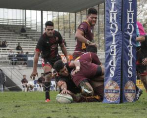 Old Boys halfback Inoke Naufahu scores a try against Athletic Marist in their Citizens Shield...