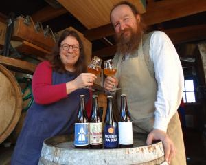 Lee-Ann Scotti and Michael O'Brien, of Oamaru's Craftwork Brewery, raise a glass to celebrate the...