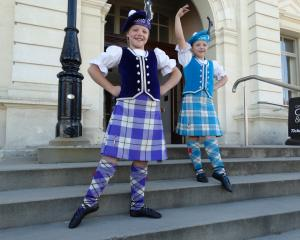 Twins Gemma (left) and Laura Aker (8) pose outside the Oamaru Opera House where they danced in...