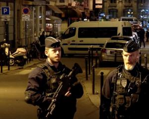 Police guard the scene of a knife attack in Paris. Photo: Reuters