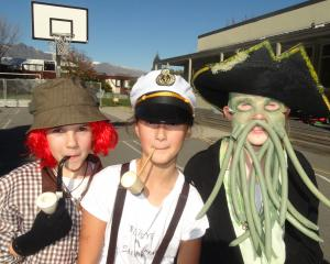 Dressed as book characters are St Joseph's School pupils (from left) Mala Januszkiewicz  (10) as...