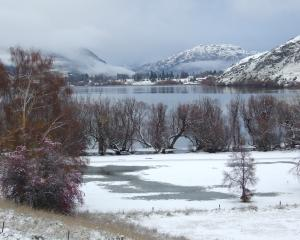 Snow covers the mountains surrounding Lake Hayes this morning. Photo: Guy Williams