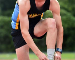 Sam Bremer laces his running shoes at the Caledonian Ground last year. Photo: ODT