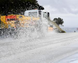 A snow-plough clears the Northern Motorway. Photo: Stephen Jaquiery