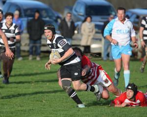 Crescent first five-eighth Harley McHardy slips out of the tackle of Clutha prop Daniel Miller as...