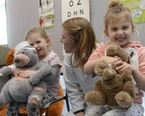 Ivy Westhead (3, left) and Ayisha Hynes (4) cuddle their stuffed toys after a successful...