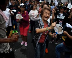 Anti-government protesters gather in Bangkok to demand that the military government hold a...