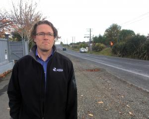 Dunedin City Council transportation safety team leader Hjarne Poulsen inspects a section of...