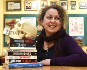 Dunedin crime novelist Dr Vanda Symon with a model skull and several books, including her first...
