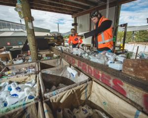 Wanaka Wastebusters Gabriel Schwarz (left) and ben Taylor hand-sort recycled plastics and cans....