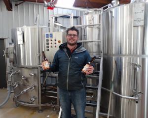 Altitude brewing partner Eliott Menzies shows off his award-winning beer. Photo: Josh Walton