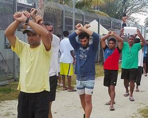 Detainees stage a protest inside the compound at the Manus Island detention centre. Photo:...