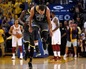 Golden State Warriors guard Stephen Curry (30) reacts after a play during the second quarter...