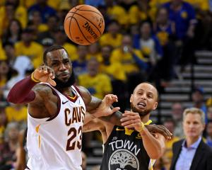 Golden State Warriors guard Stephen Curry (30) and Cleveland Cavaliers forward LeBron James (23)...