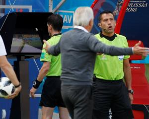 Referee Andres Cunha reviews a incident on VAR before awarding a penalty to France during its...