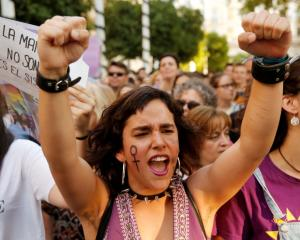 People take part in a a demonstration in Seville against the release on bail of the five men...