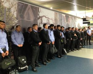 The All Blacks line up to be welcomed at Duendin Airport this evening. Photo: Linda Robertson
